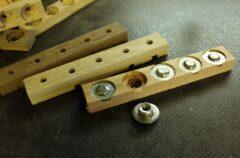 Holzleiste mit Inserts