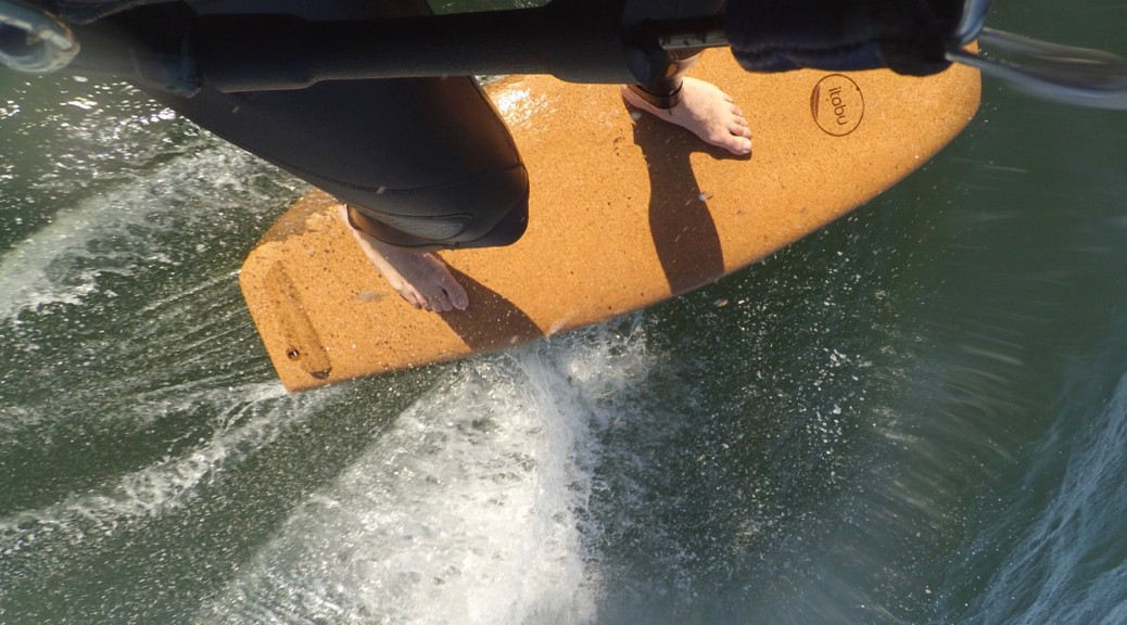 wooden surfboard with cork deck