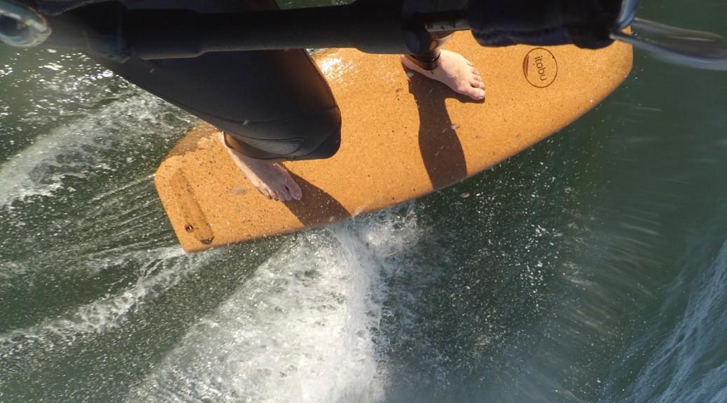 wooden surfboard with cork deck